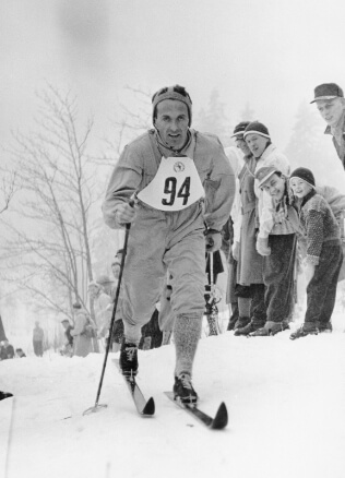 old man skiing in odlo clothes